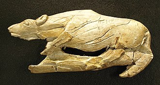 "Swimming Reindeer - ""Rampant Hyena"" carving found at Abri de la Madeleine, also in France."