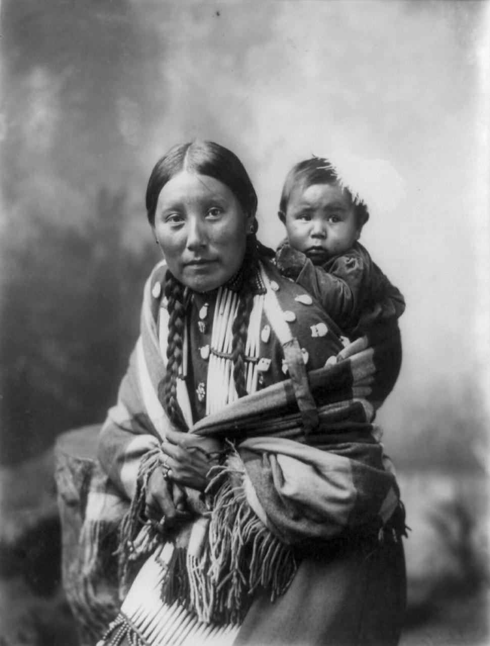Stella Yellow Shirt, Dakota Sioux, with baby, by Heyn Photo, 1899