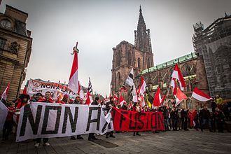 "Protesters of the Alsace independence movement holding a banner saying ""No to merger"" (Non a la fusion), 2014 in Strasbourg. Strasbourg manifestation contre la fusion des regions 23 novembre 2014.jpg"