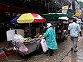 Street food vendor, rainy afternoon, Soi Cowboy, Bangkok (44473846425).jpg