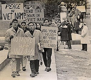 "Draft evasion - U.S. anti-Vietnam War protesters at the University of Wisconsin–Madison. A placard to the right reads ""Use your head – not your draft card""."