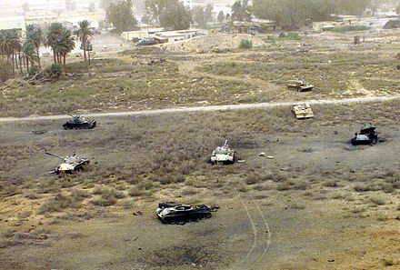The destroyed remains of Iraqi tanks and other armored vehicles litter an Iraqi military complex west of Diwaniyah T-54s, T-55s, Type 59s or Type 69s at Diwaniyah, Iraq.jpg