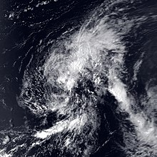 Satellite image of a weak tropical cyclone. The storm is characterized by disorganized cloud cover that encompasses most of the image. No land masses are visible in the image.