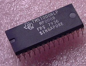 "Texas Instruments TMS1000 - A TMS1000 ""computer on a chip"". The date code on this part shows it was made in 1979.  It is in a 28 pin plastic dual-in-line package."