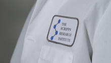 A lab coat with a The Scripps Research Institute patch