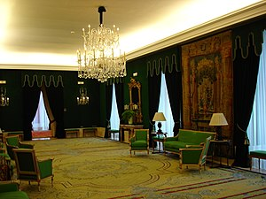 "Green room - Salón Verde (""Green Hall"") at the Royal Theatre (Teatro Real) in Madrid (Spain). Note that the chairs, curtains and walls are predominantly green, from which the room takes its name."