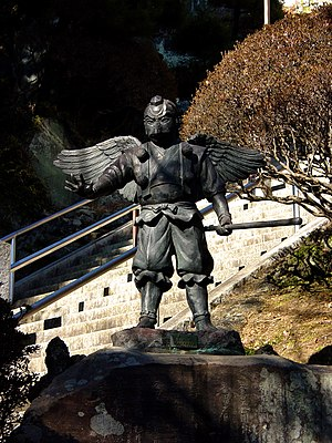 Tengu statue near a Hansobo shinto shrine on t...