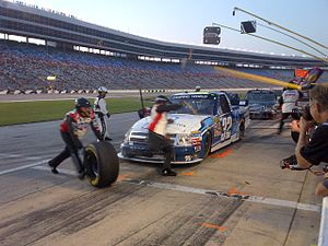 Camping World Truck Series - Miguel Paludo's team performs a pit stop at Texas Motor Speedway in 2012