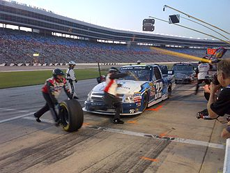 NASCAR Gander Outdoors Truck Series - Miguel Paludo's team performs a pit stop at Texas Motor Speedway in 2012