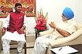 The Chief Minister of Jharkhand, Shri Arjun Munda meeting the Deputy Chairman, Planning Commission, Shri Montek Singh Ahluwalia for finalizing plan size for 2012-13 for the State, in New Delhi on August 06, 2012.jpg