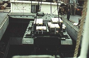The M48 Patton tank is carefully lowered into hatch 3 of TS Nabob, NY - 1959.jpg
