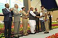The Union Home Minister, Shri Rajnath Singh presenting the Police Medal for Gallantry on the occasion of the Valour day of Central Reserve Police Force, in New Delhi (1).jpg