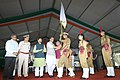The Union Home Minister, Shri Rajnath Singh presenting the colours to the Student Police Cadet (SPC) Haryana Platoon Commander, during the launch of the Student Police Cadet (SPC) programme for nationwide implementation.JPG
