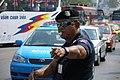 Traffic in central Bangkok, Traffic police, Thailand.jpg