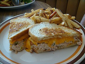 Tuna fish sandwich - A tuna melt sandwich served with French fries