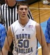 Tyler Hansbrough is wearing a North Carolina jersey on the court