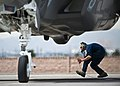 U.S. Air Force Senior Airman Alexander Orchard crouches under the exhaust of an F-35A Lightning II as the aircraft is prepped for a training mission at Nellis Air Force Base, Nev., on April 4, 2013 130404-F-KX404-974.jpg