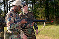 U.S. Air Force Staff Sgt. Daniel Hensley, right, assigned to 314th Security Forces Squadron, assists Tech. Sgt. Patrick Johnson, assigned to 314th Civil Engineering Squadron, with his M-16 rifle at Little Rock 070426-F-OD942-013.jpg