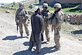 U.S. Army Capt. Alex A. Kaivan, center right, the commander of Baker Company, 1st Battalion, 506th Infantry Regiment, 4th Brigade Combat Team, 101st Airborne Division, speaks with a resident in Paktia province 130529-A-CW939-083.jpg