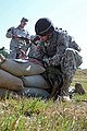U.S. Army Pfc. Cameron Loehr, assigned to the 1st Battalion, 4th Infantry Regiment prepares a 9-line medical evacuation request for a simulated casualty during the Joint Multinational Readiness Center's Expert 130806-A-HE359-047.jpg