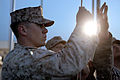 U.S. Marine Corps Cpl. Brett MegarityKoch hoists a U.S. flag at Camp Leatherneck, Helmand province, Afghanistan, March 15, 2013 130315-M-KS710-076.jpg