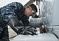 U.S. Navy Aviation Structural Mechanic Airman Travis Lindelov, assigned to Helicopter Maritime Strike Squadron (HSM) 71, washes an MH-60R Seahawk helicopter at Naval Air Station North Island, Calif., Oct. 28 131028-N-AG657-025.jpg