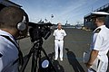 U.S. Navy Capt. Christopher Westbrook, center, the lead medical planner for Pacific Partnership 2013, is interviewed before the amphibious dock landing ship USS Pearl Harbor (LSD 52) leaves Joint Base Pearl 130525-N-WD757-031.jpg