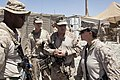 U.S. Navy Master Chief Petty Officer Kelly McNulty, right foreground, the command master chief of Regional Command (Southwest), speaks with hospital corpsmen at Forward Operating Base (FOB) Now Zad in Helmand 130608-M-LZ389-031.jpg