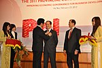 USAID Mission Director Francis Donovan receives award from VCCI Chairman Vu Tien Loc at the Provincial Competitiveness Index 2011 Launch (6778631714).jpg