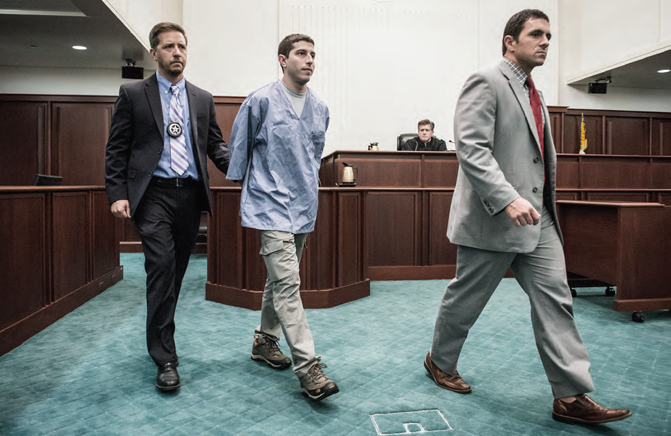 US Marshals escorting prisoner in court