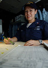 a us navy quartermaster at work in october 2002