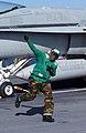 US Navy 021109-N-2410G-503 Aviation Boatswain Mate Airman runs clear before an F-A-18 launches.jpg