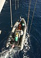 US Navy 021208-N-0275F-506 Sailors position a rigid hull inflatable boat (RHIB) under monkey lines.jpg