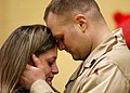 US Navy 030313-N-5576W-005 U.S. Marine Reservist Sgt. Jim Raap comforts his girlfriend prior to boarding a chartered flight bound for the Central Command area of responsibility (AOR) in the Arabian Gulf region.jpg