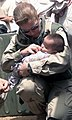 US Navy 030408-M-5607A-013 Hospital Corpsman 1st Class Maureen Smith assigned to Marine Wing Support Squadron Two Seventy-One (MWSS-271) examines an Iraqi baby.jpg