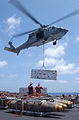 US Navy 030427-N-5781F-015 An SH-60 Seahawk hovers above flight deck aboard USS Kitty Hawk (CV 63), offloading ammunition to the ammunition ship USNS Flint (T-AE 32) during a vertical replenishment.jpg
