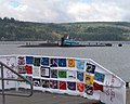 US Navy 040920-N-6497N-006 A colorful banner made by family members, awaits the crew as the Sturgeon-class submarine USS Parche (SSN 683) returns to port for the final time.jpg