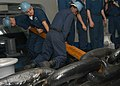 US Navy 041026-N-4565G-003 Deck Seamen assigned to First Division aboard the conventionally powered aircraft carrier USS John F. Kennedy (CV 67), work to raise the anchor after successfully completing a deep-sea anchoring exerc.jpg