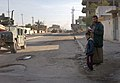 US Navy 050121-N-1810F-251 U.S. Navy Seabees assigned to Naval Mobile Construction Battalion Twenty Three (NMCB 23) patrol the streets of Fallujah, in the days leading up to Iraq's historic democratic elections.jpg