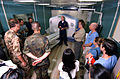 US Navy 050206-N-1450G-020 Lt. Cmdr. Ferrara, center, explains the capabilities of the CATSCAN aboard the Military Sealift Command (MSC) hospital ship USNS Mercy (T-AH 19).jpg