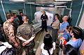US Navy 050206-N-1450G-020 Lt. Cmdr. Ferrara, center, explains the capabilities of the CATSCAN aboard the Military Sealift Command (MSC) hospital ship USNS Mercy (T-AH 19).jpg
