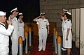 US Navy 050610-N-0435H-039 Cmdr. Bess McAndrew salutes her staff one last time, after twenty-one years of honorable service, as she is piped through the ceremonial sideboys.jpg