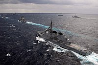 US Navy 051115-N-8492C-125 The Japan Maritime Self-Defense Force (JMSDF) destroyer JDS Kongou (DDG 173) sails in formation with other JMSDF ships and ships assigned to the USS Kitty Hawk Carrier Strike Group