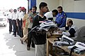US Navy 061022-M-8213R-011 Iraqi police members receive new equipment such as shoes, shirts, helmets, handcuffs, and pistol holsters to better equip them in maintaining law and order in the city of Baghdadi, Iraq.jpg