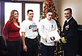 US Navy 061217-O-0000L-010 Newly frocked Machinist Mate 3rd Class Matthew Bove receives his frocking letter and new rank insignia from USS Frank Cable (AS 40) Commanding Officer Capt. Leo Goff.jpg