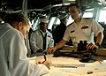 US Navy 070429-N-1328S-001 Sailors aboard the amphibious assault ship USS Boxer (LHD 4) plot the ship's course as they pull into Fremantle for a port visit during their Western Pacific deployment.jpg