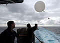 US Navy 070628-N-7981E-056 Aerographer's Mate 3rd Class Doron Dill and Aerographer's Mate Airman Shane Green launch a weather balloon off the fantail of Nimitz-class aircraft carrier USS Abraham Lincoln (CVN 72).jpg