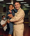 US Navy 070719-N-7088A-002 Capt. Bob Kapcio, mission commander aboard Military Sealift Command hospital ship USNS Comfort (T-AH 20), poses for a picture with a patient awaiting medical care.jpg