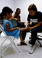 US Navy 070926-N-6278K-088 Kris McHarg, a pediatric nurse practioner and Project Hope volunteer attached to Military Sealift Command hospital ship USNS Comfort (T-AH 20), examines A little girl's foot.jpg