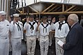 US Navy 080704-N-4680O-121 Vice President of the United States Dick Cheney admisiters the reenlistment oath to Sailors from the multi-purpose amphibious assault ship USS Bataan (LHD 5) and the USS Constitution during a reenlist.jpg
